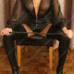 Mistress Erika sitting on a chair Erotic Mistress