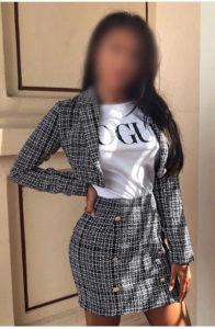 Woking escort Neena in a short skirt and jacket