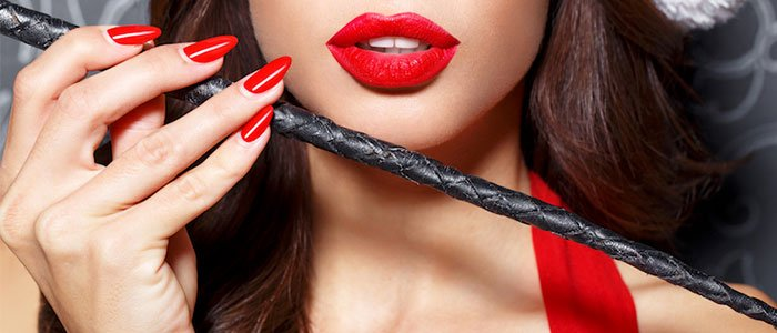 Surrey mistresses, erotic practices, beautiful red lips, whip.