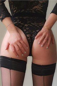Escort holding her peachy bottom cheeks