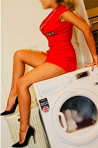 Zara enjoys sitting on her washing machine through spin cycle