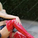 Blonde Escort in Surrey, thigh high red PVC boots,