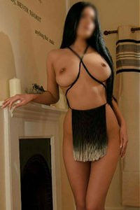 Erika large breasts, semi-naked against fireplace
