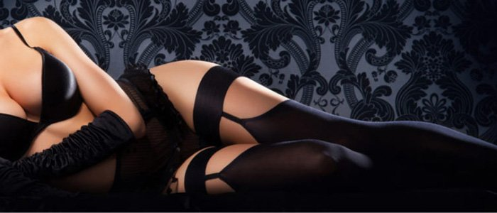 Escorts in Surrey, reclining black lingerie