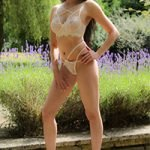 Perfectly poised Lara, Surrey escort, garden backdrop