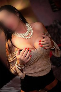 Mature Escort, red nails, holding big breasts