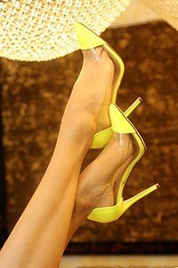 Yellow high heels close up, foot fetish