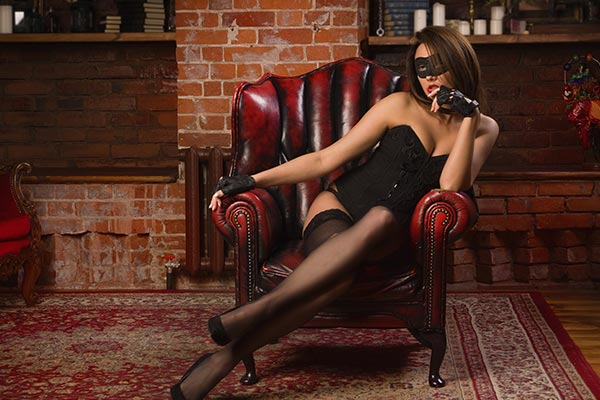 A red leather chair, women in lingerie